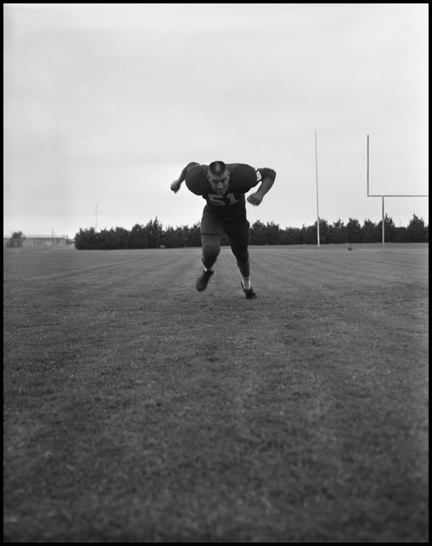 [Football Player No. 51 Running in a Blocking Position, September 1962]                                                                                                      [Sequence #]: 1 of 1