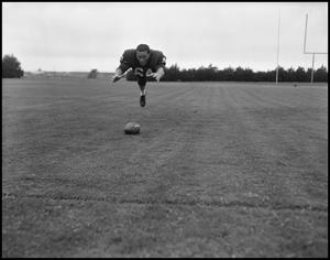 Primary view of object titled '[North Texas State University Jersey No. 64 Football Player, September 1962]'.