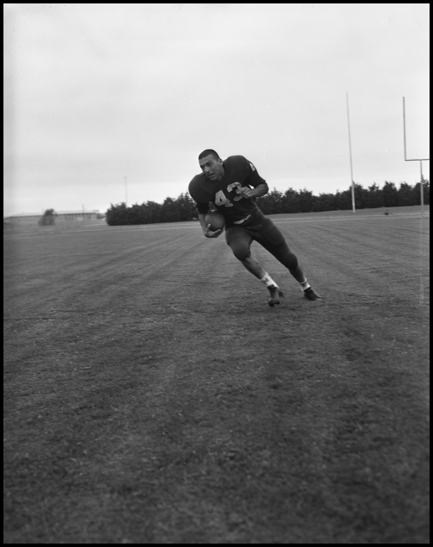 [Football Player No. 43 Running with a Football, September 1962]                                                                                                      [Sequence #]: 1 of 1