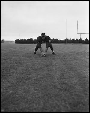Primary view of object titled '[Football Player No. 51 in a Snap Position, September 1962]'.
