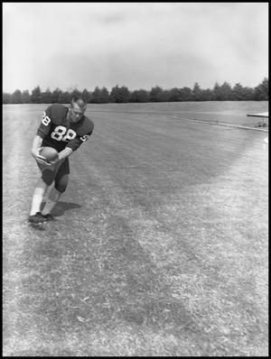 Primary view of object titled '[Football Player No. 88 Winston Freeman, September 1960]'.