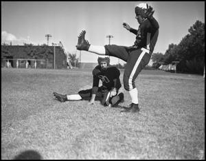 Primary view of object titled '[Two Football Players]'.
