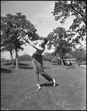 Primary view of object titled '[Individual Man Swinging Golf Club]'.