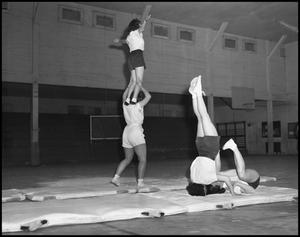 Primary view of object titled '[Women's Gymnastics Students Practicing Stunts, 1942]'.