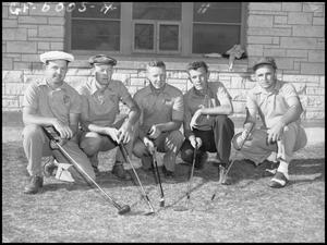 Primary view of object titled '[North Texas State Golf Team Kneeling]'.