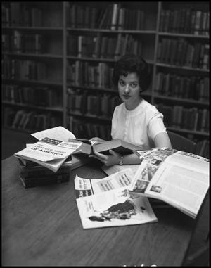 Primary view of object titled '[Anne Hodges at the Library]'.