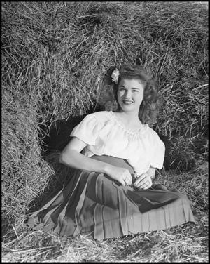 Primary view of object titled '[Virginia Haug Sitting on Straw]'.