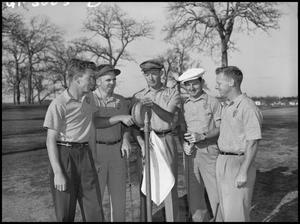 Primary view of object titled '[Men's Golf Team Standing Around Pole]'.