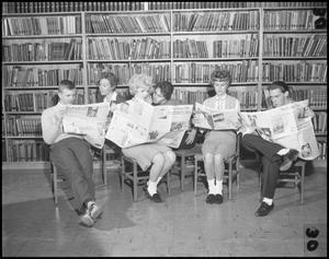 Primary view of object titled '[Students Reading Newspapers Together]'.