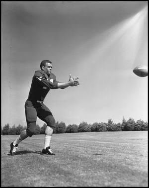 Primary view of object titled '[Football Player No. 14 Catching a Football]'.