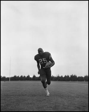 Primary view of object titled '[Football Player No. 25 Running with a Football, September 1962]'.