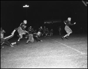Primary view of object titled '[Football game in action]'.