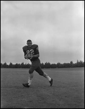 Primary view of object titled '[Football Player No. 82 Running with a Ball, September 1962]'.