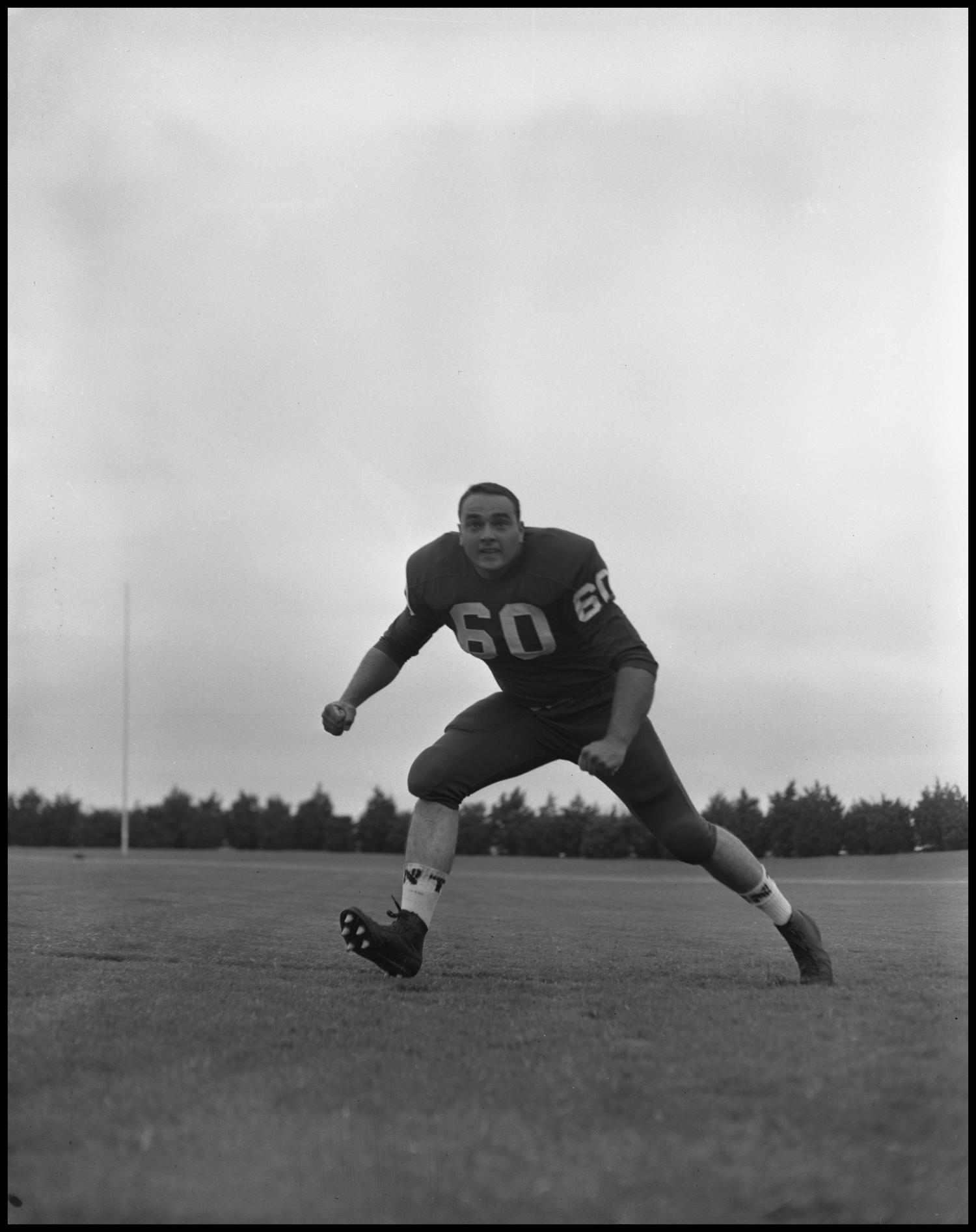 [Football Player No. 60 Running on the Field, September 1962]                                                                                                      [Sequence #]: 1 of 1