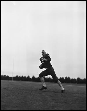 Primary view of object titled '[Football Player No. 24 Running with a Ball, September 1962]'.