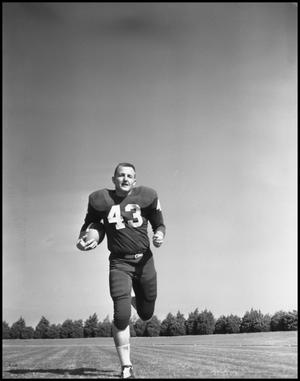 Primary view of object titled '[Jersey Number 43 Football Player Running, 1961-1962]'.