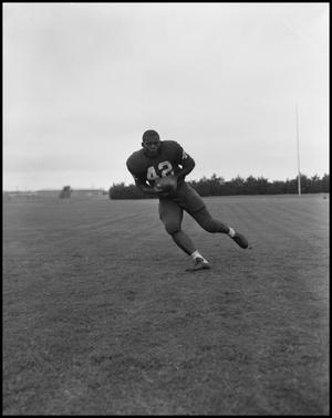 Primary view of object titled 'Football Player No. 42 Running with a Football, September 1962]'.