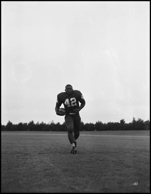 Primary view of object titled '[Football Player No. 42 Running with a Football, September 1962]'.