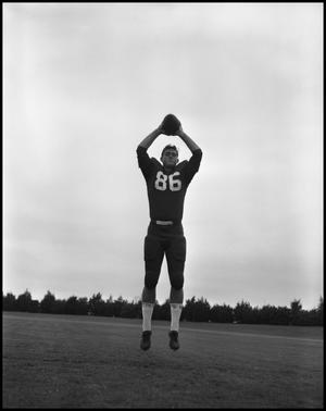 Primary view of object titled '[Football Player No. 86 Catching a Football, September 1962]'.