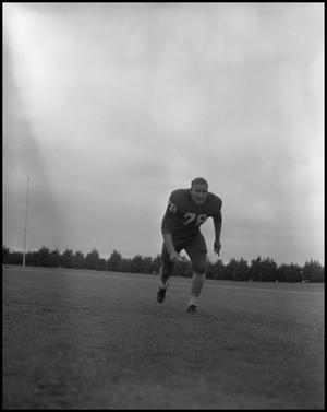 Primary view of object titled '[Football Player No. 78 Running on the Field, September 1962]'.