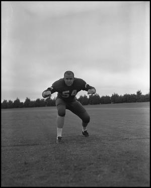 Primary view of object titled '[Football Player No. 54 in a Blocking Position, September 1962]'.