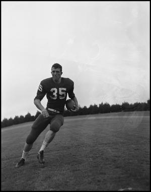 Primary view of object titled '[Football Player No. 35 Running with a Ball, September 1962]'.