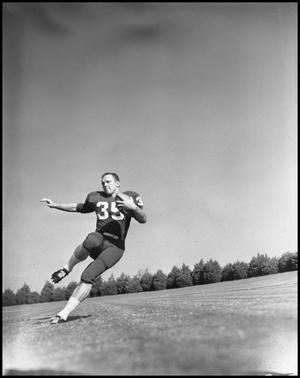 Primary view of object titled '[Football Player No. 35 in Action, 1961-1962]'.