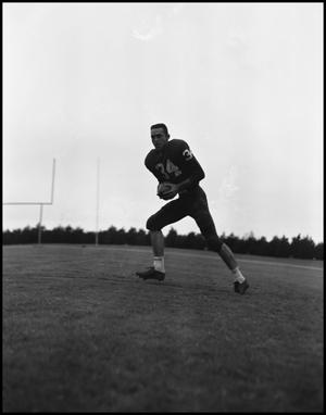 Primary view of object titled '[David Lancaster running with football]'.