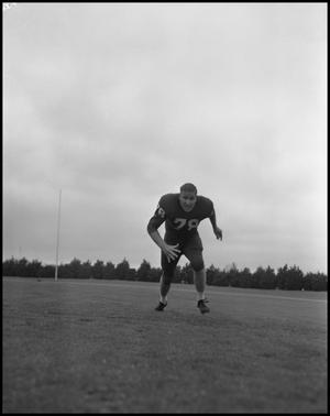 Primary view of object titled '[Football Player No. 78 Running Low on the Field, September 1962]'.