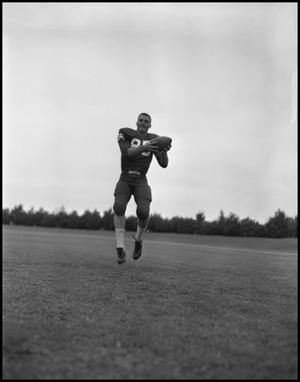 Primary view of object titled 'Football Player No. 85 Catching a Football, September 1962]'.