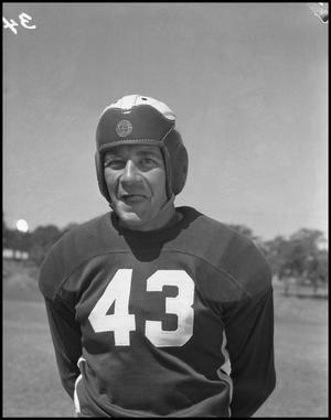 Primary view of object titled '[Jersey Number 73 Football Player]'.
