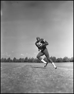 Primary view of object titled '[Football Player No. 25 Running with a Football]'.