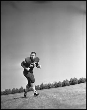 Primary view of object titled '[Football Player No. 62 Running on the Field]'.