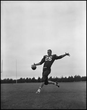 Primary view of object titled '[Football Player No. 26 About to Kick the Ball, September 1962]'.