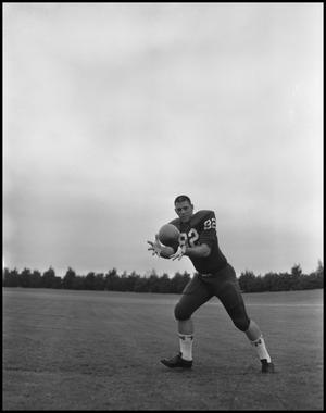 Primary view of object titled '[Football Player No. 82 Catching a Football, September 1962]'.