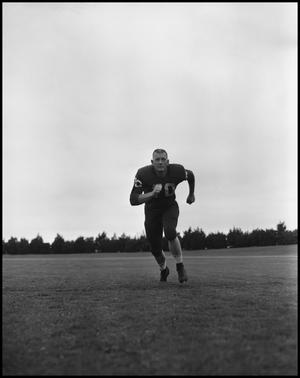 Primary view of object titled 'Football Player No. 70 Running on the Field, September 1962]'.