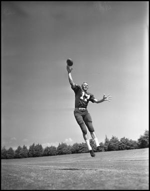 Primary view of object titled '[Number 17 Football Player Catching a Football]'.