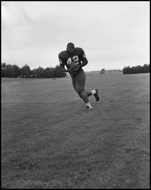 Primary view of object titled '[Football Player No. 42 Running with the Ball, September 1962]'.