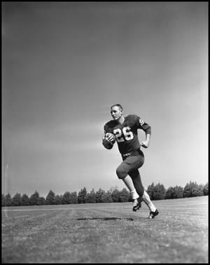 Primary view of object titled '[Number 26 Football Player Running with a Ball]'.
