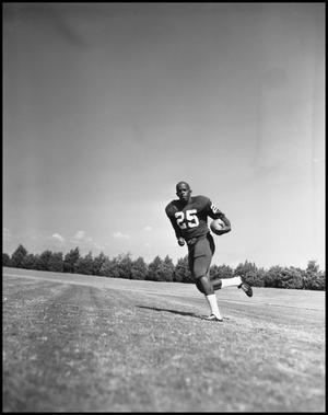 Primary view of object titled '[Number 25 Football Player Running with the Ball]'.