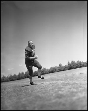 Primary view of object titled '[Football Player No. 70 Running on the Field]'.