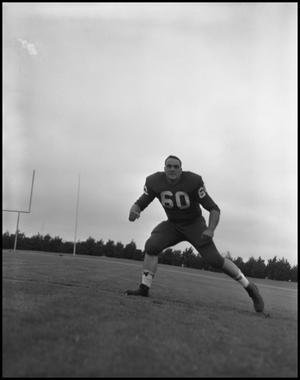 Primary view of object titled '[Football Player No. 60 in a Blocking Position, September 1962]'.