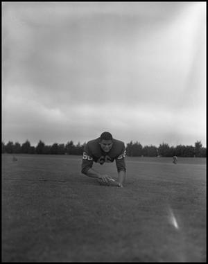 Primary view of object titled '[Football Player No. 66 Diving for the Ball, September 1962 #1]'.