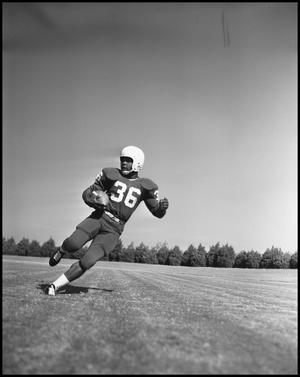 Primary view of object titled '[Number 36 Football Player Running, 1961-1962]'.