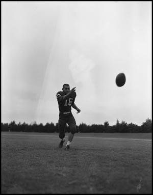 Primary view of object titled '[Football Player No. 16 Running towards the Football Flying through the Air, September 1962]'.