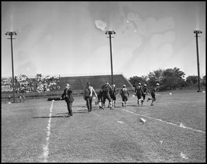Primary view of object titled '[Men on Football Field]'.
