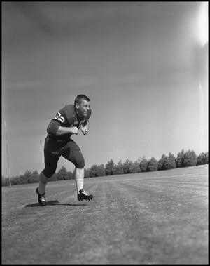 Primary view of object titled '[Football Player No. 26 Running in a Blocking Position, 1961-1962]'.