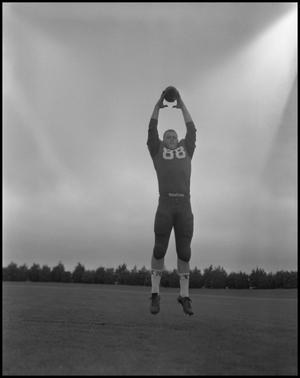 Primary view of object titled 'Football Player No. 88 Catching a Football, September 1962]'.