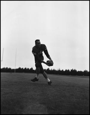 Primary view of object titled '[David Lancaster catching football]'.