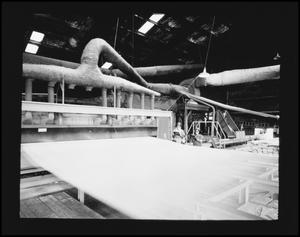 Primary view of object titled '[Skeet McAuley in a Factory]'.